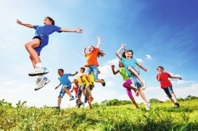 kids-jumping-in-field-390x259.jpg